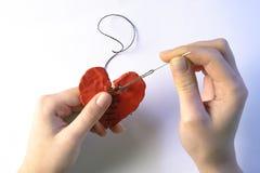 Azione di riparazione di emergenza su cuore Immagini Stock Libere da Diritti