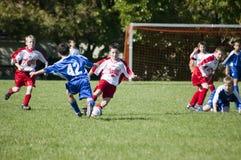 Azione maschio di calcio della gioventù Fotografie Stock
