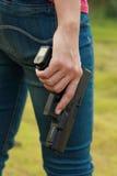 Azione sicura con una pistola Fotografia Stock