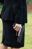 Azione sicura con una pistola Fotografie Stock Libere da Diritti