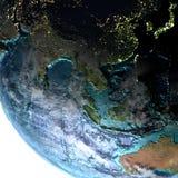 Azja Południowo-Wschodnia na ziemi przy półmrokiem Zdjęcia Royalty Free
