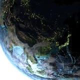 Azja Wschodnia na ziemi przy półmrokiem Obraz Stock