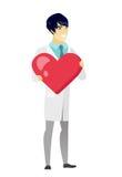 Azjata doktorski mienie duży czerwony serce ilustracji
