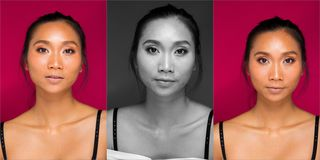 Azjata garbnikował skóry kobiety z silnymi kolor czerwieni wargami zdjęcie stock