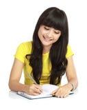 azjata książkowy szkoła wyższa dziewczyny writing zdjęcie royalty free