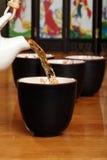 azjata polanym ziele herbatą jest Obrazy Royalty Free