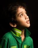 Azjatycka chłopiec odizolowywająca na czerni Obraz Royalty Free