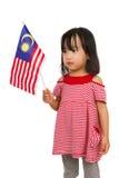 Azjatycka Chińska mała dziewczynka z Malezja flaga Obraz Royalty Free