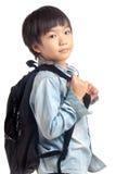 Azjatycka chłopiec z szkolnym plecakiem Fotografia Stock