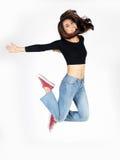 Azjatycka dama skacze na bielu Zdjęcie Royalty Free