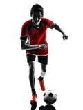 Azjatycka gracza piłki nożnej młodego człowieka sylwetka Obraz Stock
