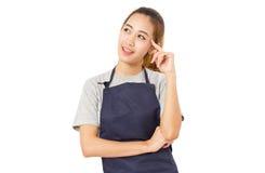 Azjatycka kobieta Jest ubranym fartucha Patrzeje Dla pomysłów Obraz Stock