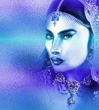 Azjatycka kobiety twarz, zamyka up z pięknym błękitnym abstrakcjonistycznym skutkiem Obrazy Royalty Free