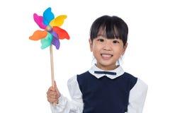 Azjatycka Mała Chińska dziewczyna Bawić się Kolorowego Pinwheel Obrazy Stock