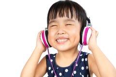 Azjatycka Mała Chińska dziewczyna z słuchawki obraz stock
