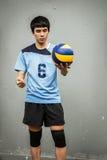 Azjatycka siatkówki atleta Z piłką obraz stock