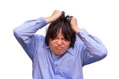 Azjatycki biurowy facet stresuje się jego ograniczenie. Obraz Stock
