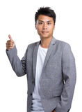 Azjatycki biznesmen pokazuje kciuk up Obrazy Royalty Free