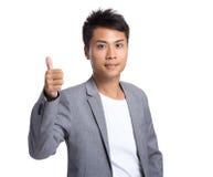Azjatycki biznesmen pokazuje kciukowi up gest Obraz Stock