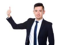 Azjatycki biznesmen pokazuje kciukowi up gest Obraz Royalty Free
