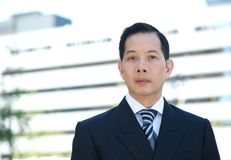 Azjatycki biznesmen z poważnym wyrażeniem Zdjęcia Stock