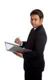 Azjatycki biznesmena chwyt falcówka i pióro Zdjęcie Royalty Free