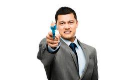 Azjatycki biznesmena mienia pistolet przewodzić Zdjęcia Stock