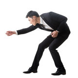 Azjatycki biznesowy mężczyzna pozuje zażartą rywalizację Obraz Royalty Free