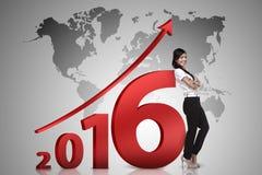 Azjatycki biznesowy osoba chudy obok 2016 liczb Obrazy Royalty Free