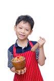 Azjatycki chłopiec szef kuchni z melonowiec sałatką Obrazy Royalty Free