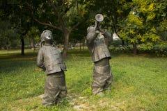 Azjatycki chińczyk, Pekin, Międzynarodowy rzeźba park, rzeźba, Bawić się suona, śpiewackie piosenki ludowa, dzieci Zdjęcie Royalty Free