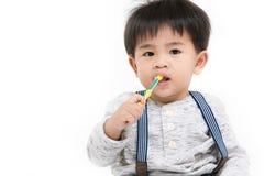 Azjatycki dzieciak na odosobnionym tle zdjęcie stock