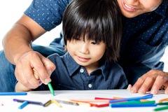 Azjatycki dzieciaka uczenie rysować Zdjęcia Stock