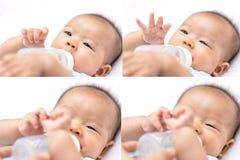 Azjatycki dziecko niemowlak cieszy się wodę pitną od butelki Obraz Royalty Free