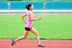 Azjatycki kobieta biegacza bieg Zdjęcia Stock