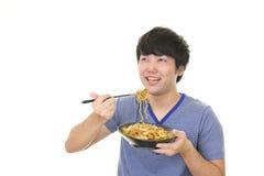 Azjatycki mężczyzna łasowania posiłek Zdjęcie Stock