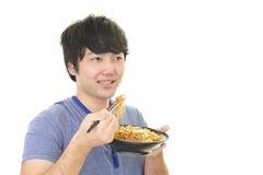 Azjatycki mężczyzna łasowania posiłek Obrazy Stock
