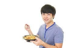 Azjatycki mężczyzna łasowania posiłek Obraz Royalty Free