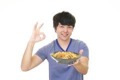 Azjatycki mężczyzna łasowania posiłek Zdjęcia Stock