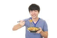 Azjatycki mężczyzna łasowania posiłek Fotografia Royalty Free