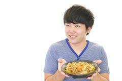 Azjatycki mężczyzna łasowania posiłek Fotografia Stock