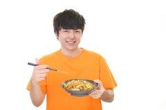 Azjatycki mężczyzna łasowania posiłek Zdjęcie Royalty Free