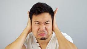 Azjatycki mężczyzna no słuchać obrazy stock
