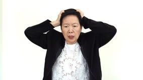 Azjatycki starszy bizneswoman stresujący się out obrazy royalty free