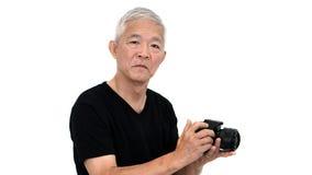 Azjatycki starszy faceta początek bierze fotografię sprzedaż dla dodatku online wewnątrz Zdjęcie Stock