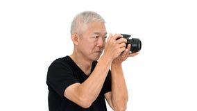 Azjatycki starszy faceta początek bierze fotografię sprzedaż dla dodatku online wewnątrz Obrazy Stock