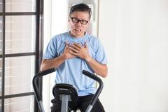 Azjatycki starszy męski serce ból Obraz Royalty Free