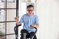 Azjatyckie starsze męskie aprobaty Fotografia Stock