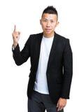 Azjatyckiego biznesmena świetny wskazywać up Fotografia Stock