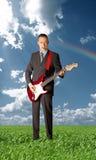 azjatykci bawić się azjatykci gitarzysta Fotografia Royalty Free